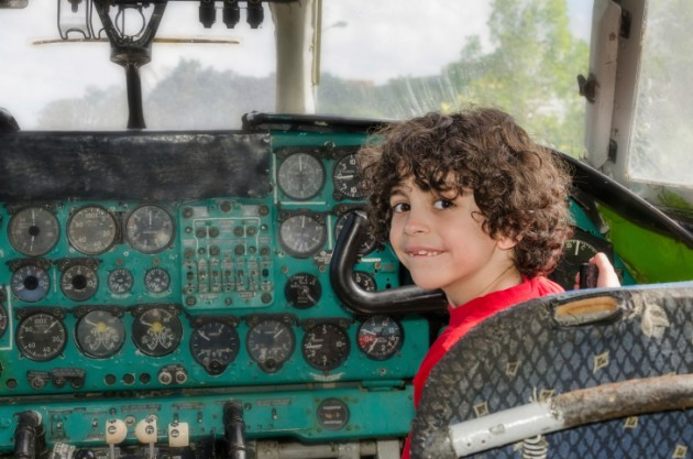 Hispanic Child Playing in an Old Plane