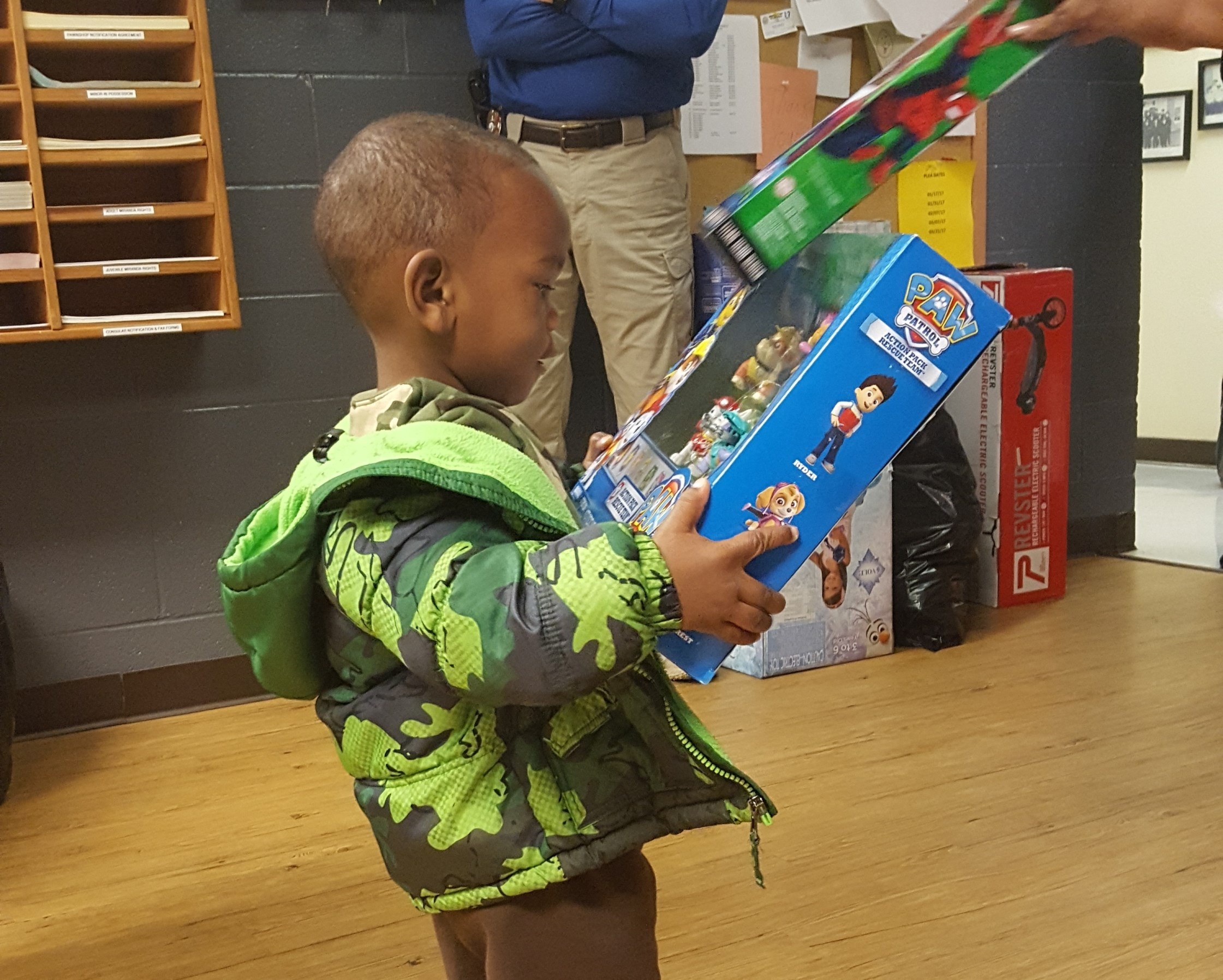Happy little guy gets new toy.  - Hope Police Department
