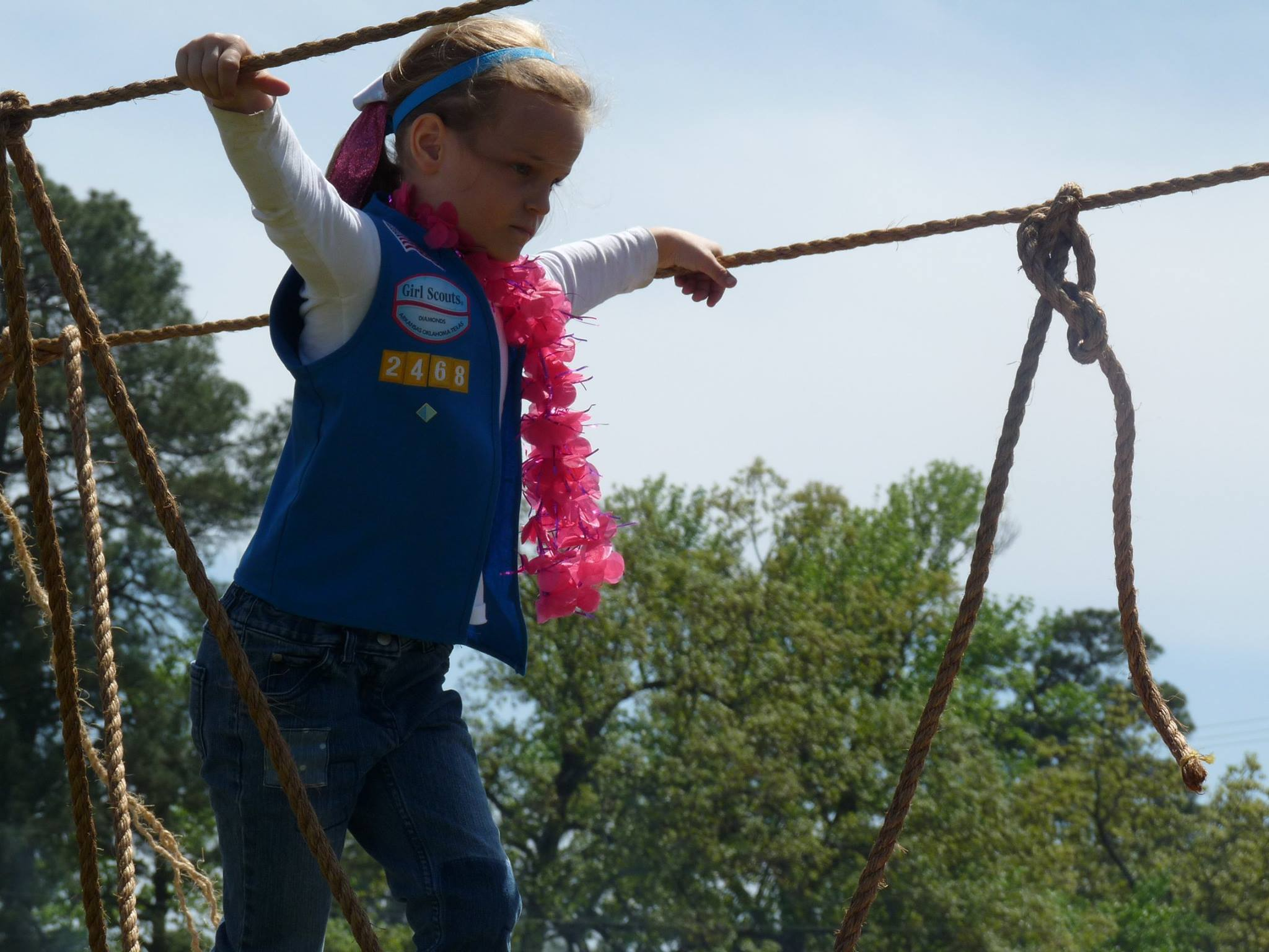 Girl Scout crossing the rope bridge - SOR 2016